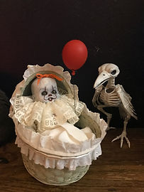 Baby Pennywise and Miniature red balloon.