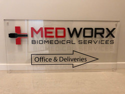 Directional signage on perspex