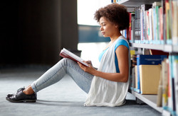 education, high school, university, learning and people concept - african american student girl read