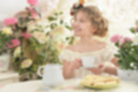 little girl drinking tea.jpg