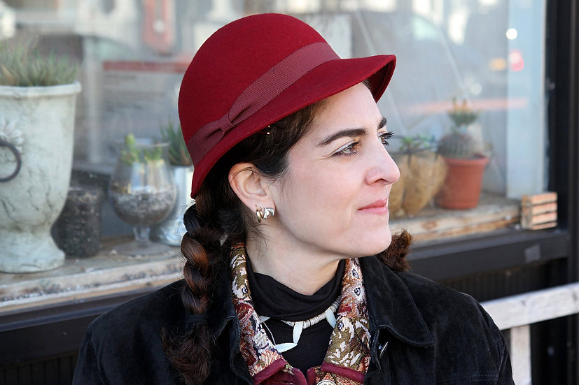 red wool hat with ribbon
