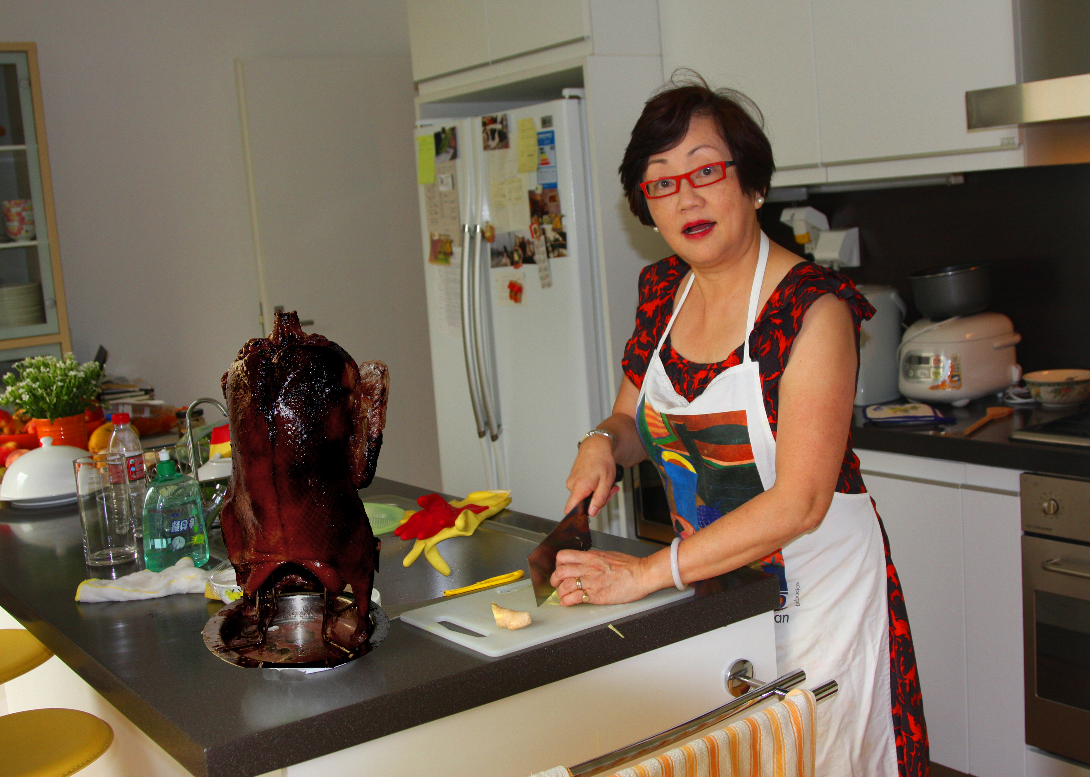 Martha in kitchen with Peking duck high res