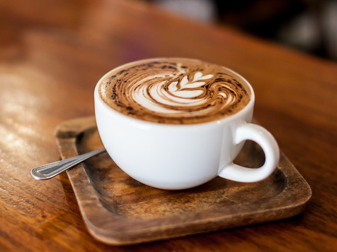 Cup of coffee latte on wood bar_ _edited
