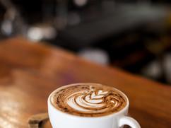 Cup of coffee latte on wood bar_ .jpg