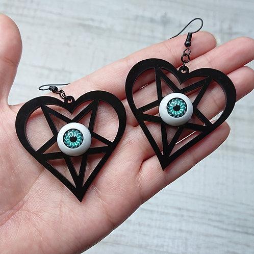 Boucles d'oreilles Coeur pentacle noirs yeux verts