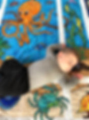 Owen testing out his quilt (close-up).jp