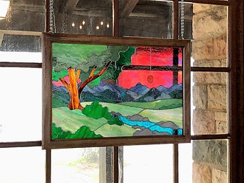 "Stained glass window entitled ""River at Sunset"""