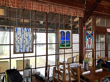 Stained glass windows in Big Meadows Lodge dining room to the right of the fireplace