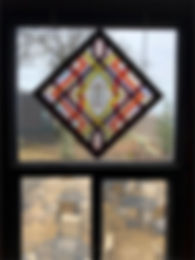 """Stained glass window entitled """"Looking Back In Time"""""""