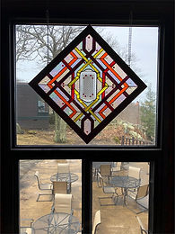"Stained glass window entitled ""Looking Back In Time"""