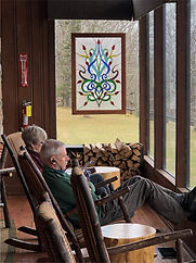 "Guests enjoying the view with staind glass window entitled ""Woven Orchids"" in the background"