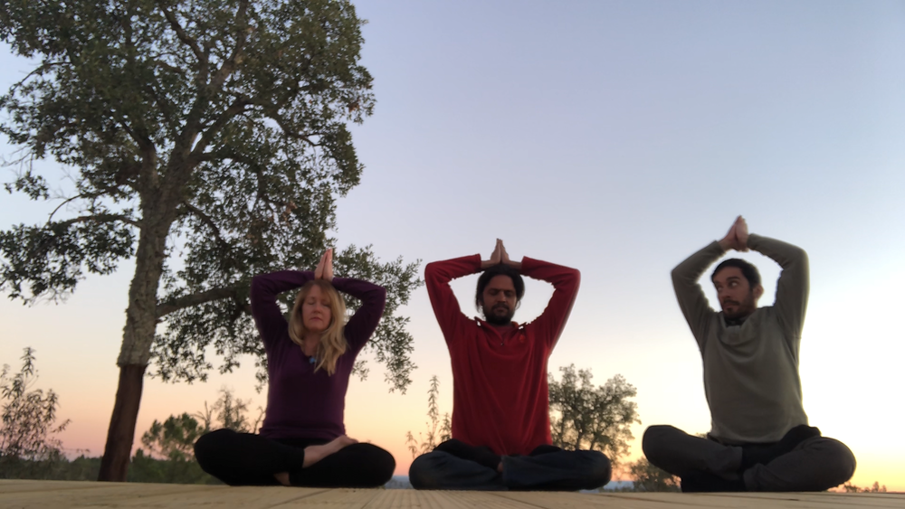Jnandev in Padmasana, Marcio and Vidya in Ardha Padmasana, with Kailash Mudra