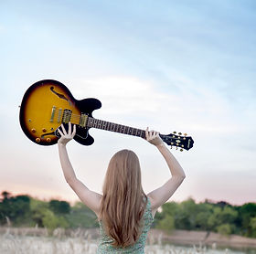 Girl holding electric Guitar