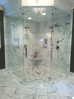 Heavy plate clamped steam shower with glass to glass hinges