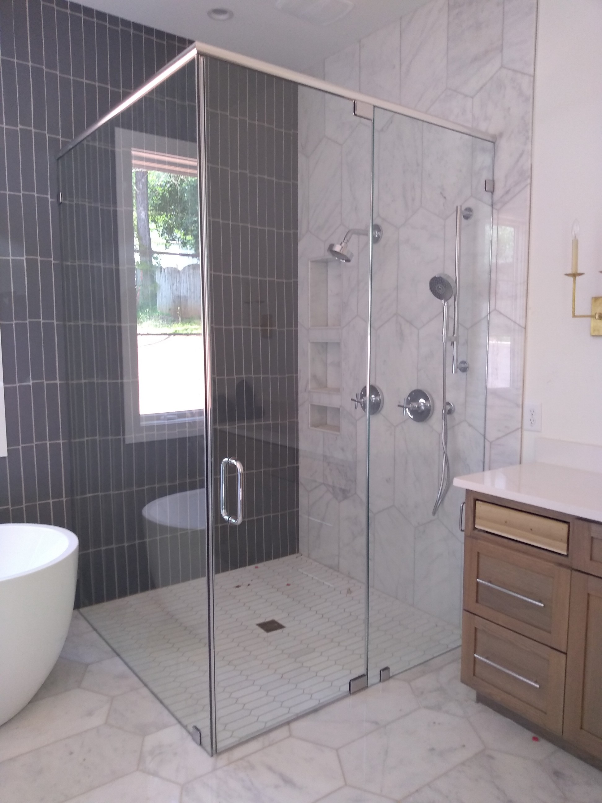 Curbless Shower with Pivot Hinge
