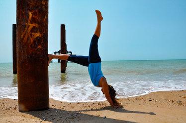 practicing handstand on Brighton beach