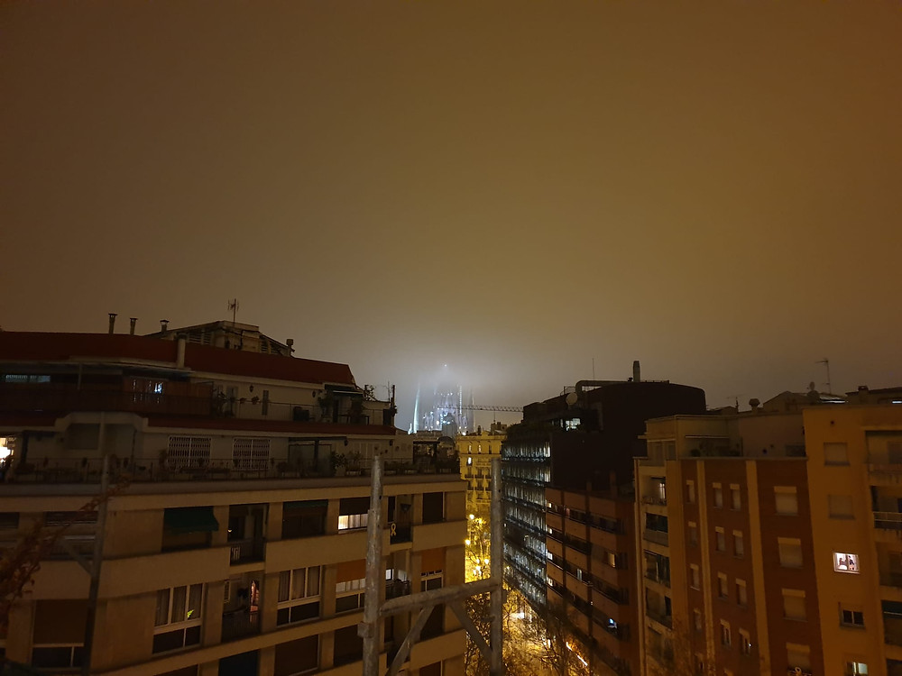 An erie view of Barcelona at night from author's appartment during lockdown