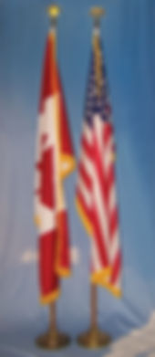 Oak flagpole display with Canada and American flags.