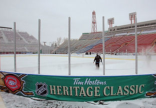 Scrim added around the new rink at Winter Classic.