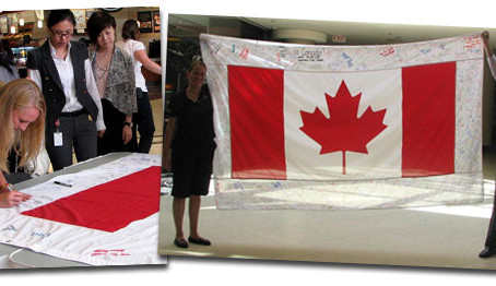 Signing a Canadian Flag