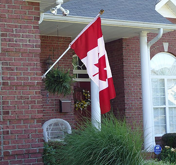 6 foot spinning flagpole mounted to house.
