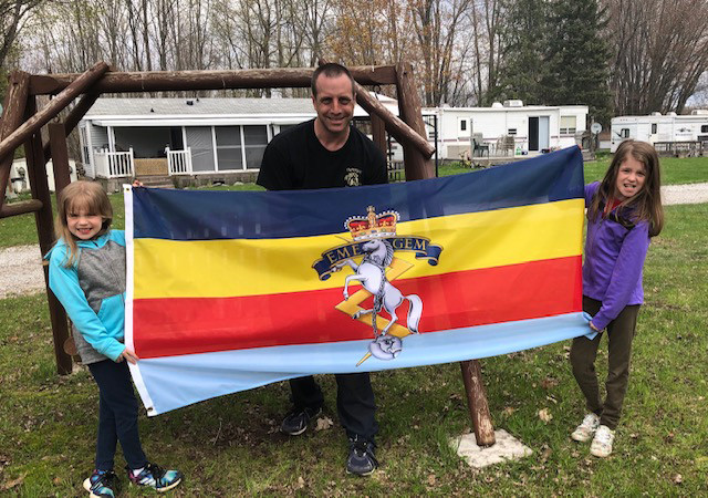 Marty showing his new RCEME flag he won in the draw on May 16.