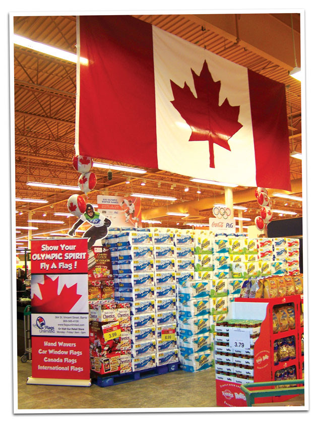 Large Canada flag hanging in the ceiling at local grocery store.