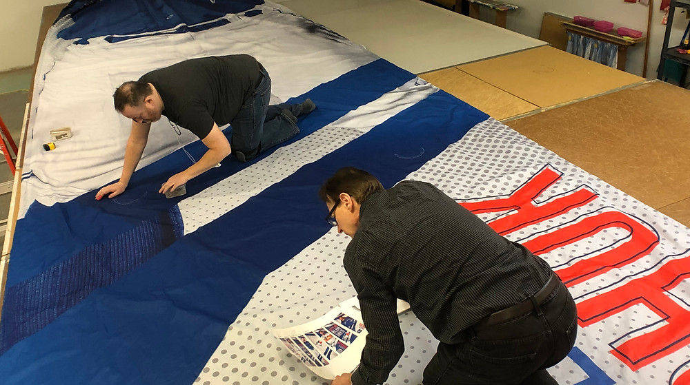 Marking wind vents on large format banners.