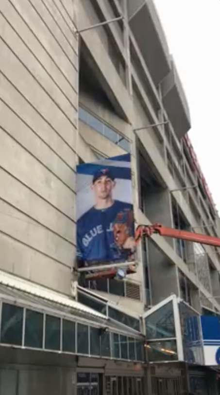 Screen shot of the video of the Blue Jays Banners being installed at the Rogers Centre.
