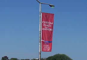 Custom banner hanging from Flags Unlimited's Windtracker system.