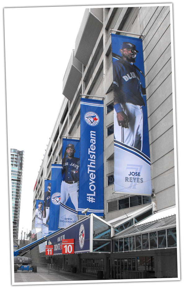 Large outdoor banners hanging from the Rogers Centre produced by Flags Unlimited.