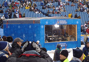 Scrim added around a video and media booth at Winter Classic.