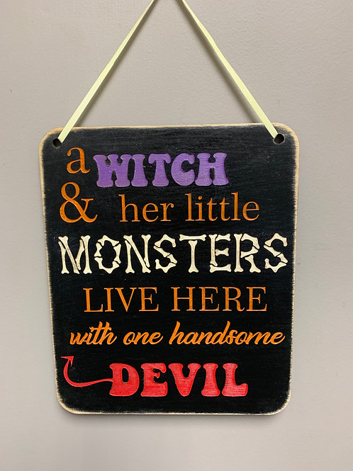 """A witch & her little monsters live here with one handsome devil"" Halloween Sign"