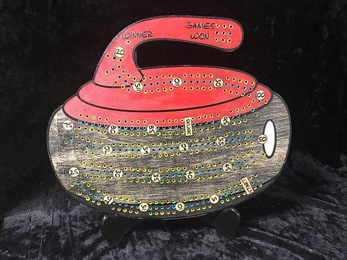 Curling rock Crib board with curling broom pegs.