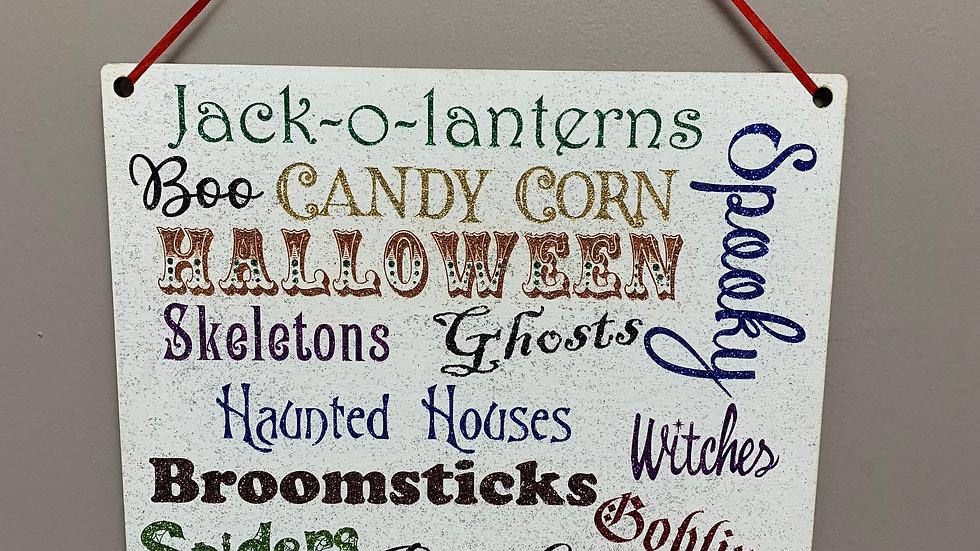 Glittered rainbow Halloween words sign