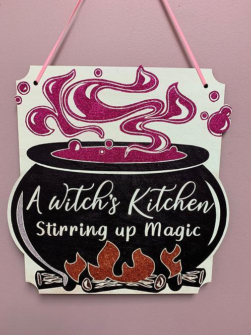 """A witch's kitchen stirring up magic"" Glitter Halloween Sign"