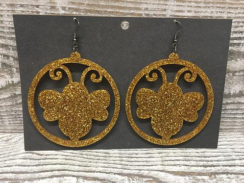 Large gold glitter bee acrylic hoop earrings.