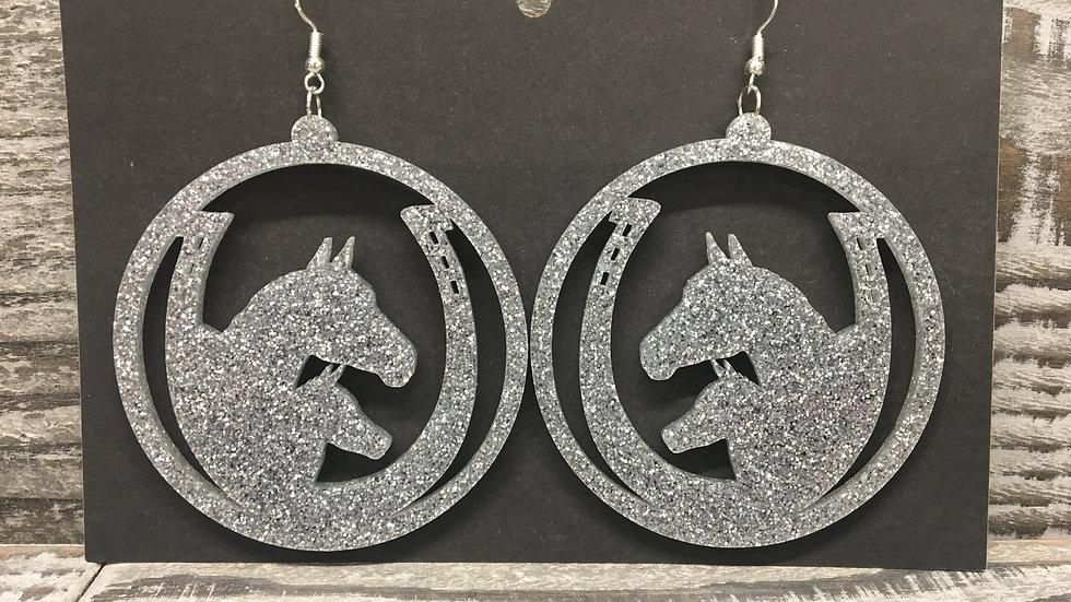Large western glitter acrylic hoop earrings.