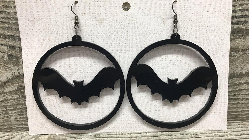 Large black bats acrylic hoop earrings.