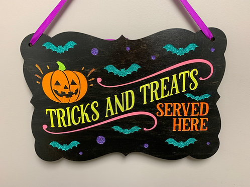 """""""Tricks and treats served here"""" Glitter Halloween decor sign"""