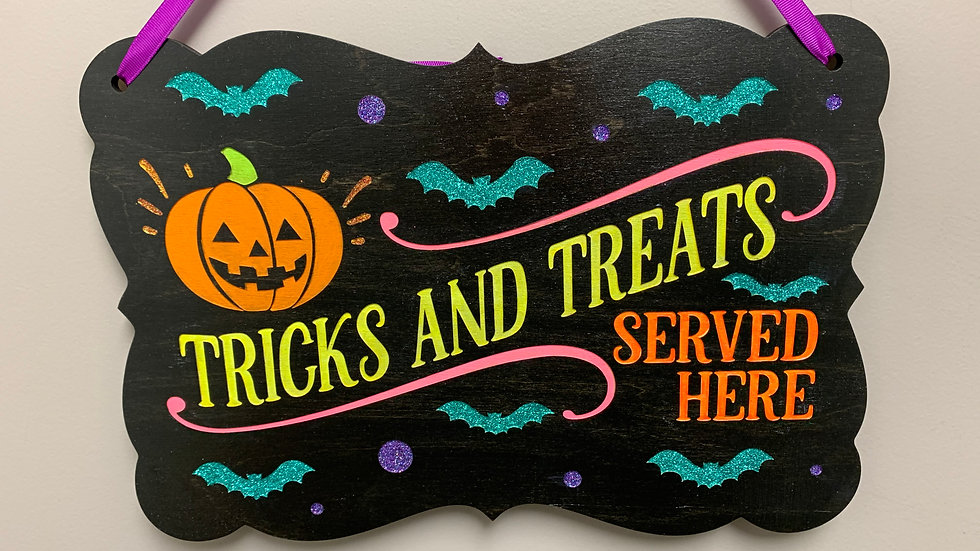 """Tricks and treats served here"" Glitter Halloween decor sign"