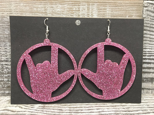 Large pink glitter sign language I love you acrylic earrings.