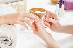 Closeup shot of a woman using a cuticle