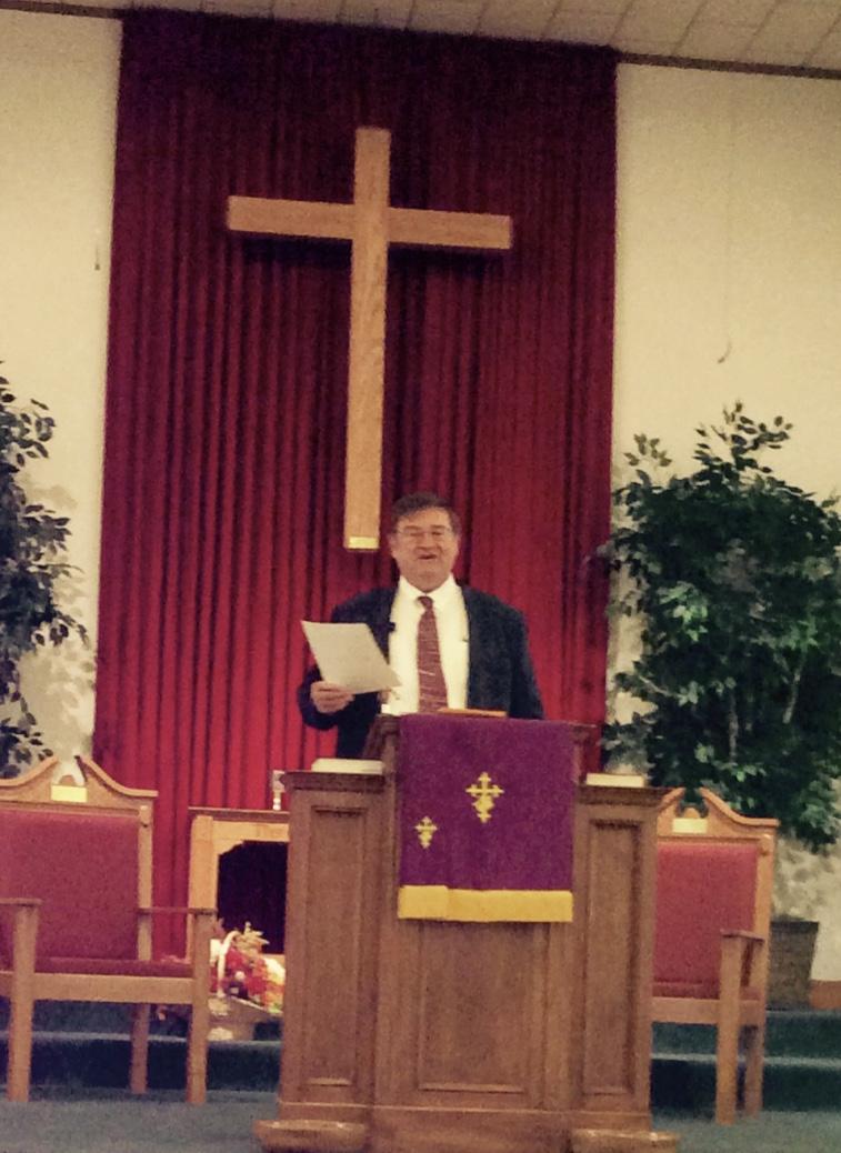 Pastor Clyde preaching