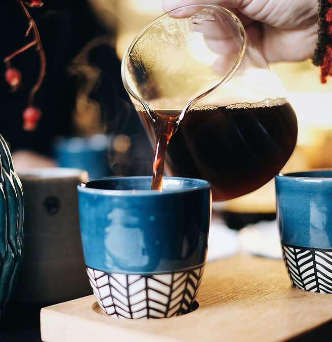 person-pouring-tea-on-cup-1710023-2.jpg