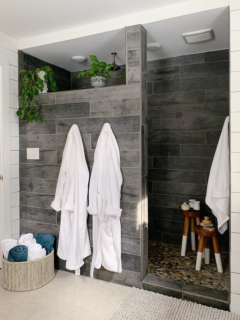 plant in the shower, wood tile shower