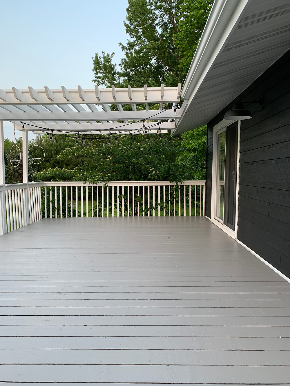 Black house with gray stained deck