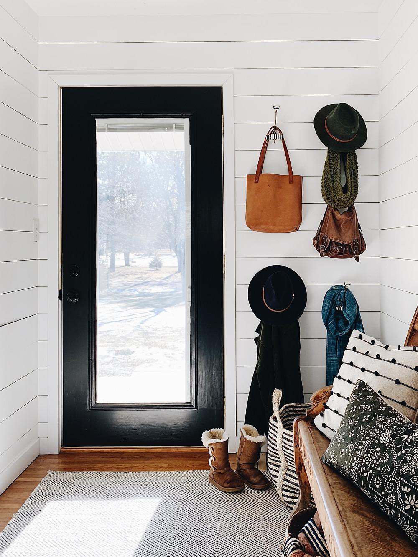 Shiplap Foyer with Black Door