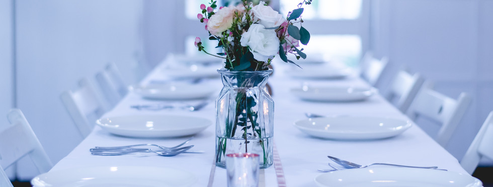 Fresh floral decorations with runner & tea light candle