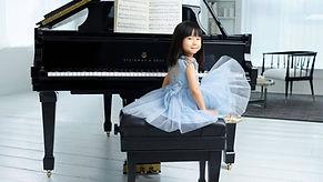 girl in front of piano.jpg